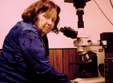 Lida Mattman at her microscope